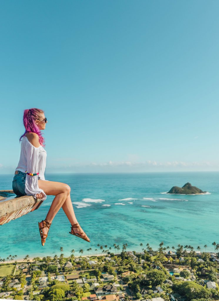 best things to do in Oahu; girl sitting and looking at view from the Lanikai Pillbox trail hike