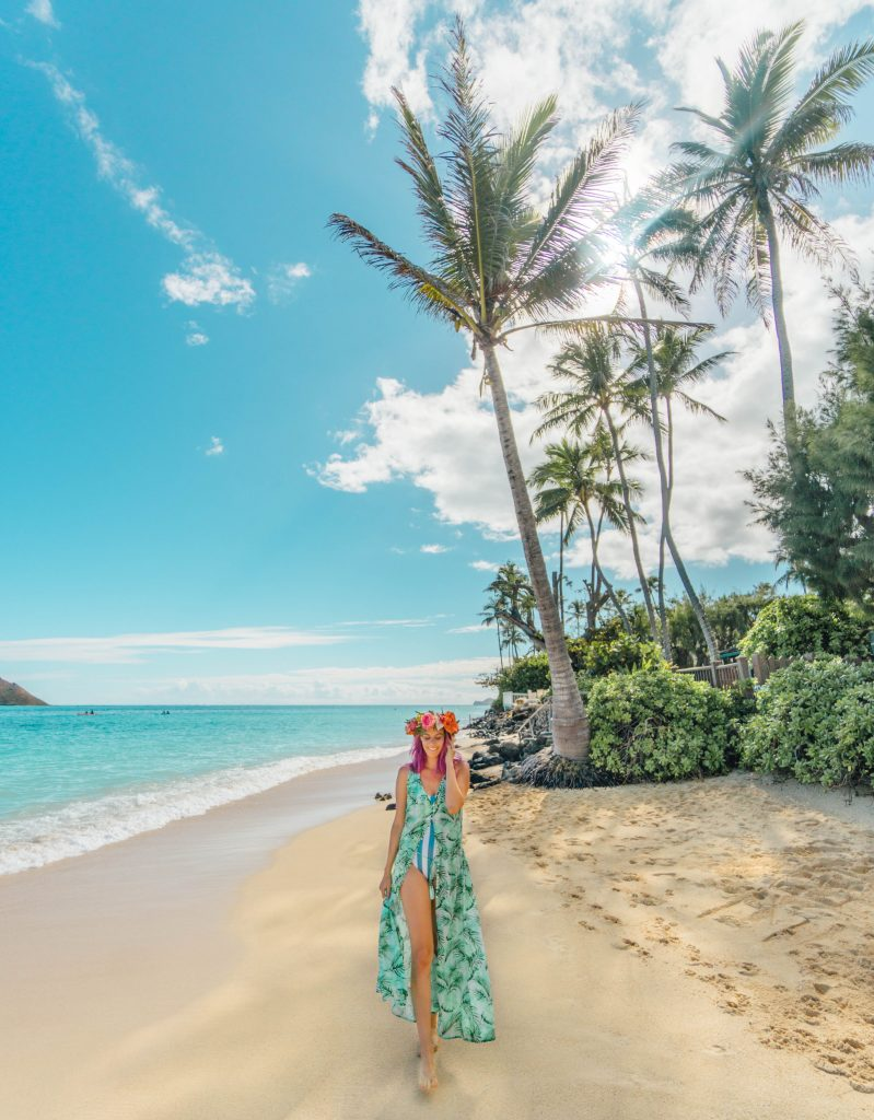 best things to do in Oahu; girl swimwear and flower crown on Lanikai beach